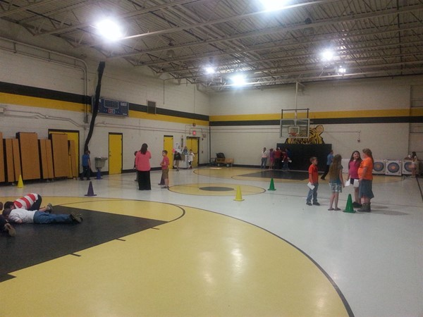 Measuring area and perimeter in the gym.