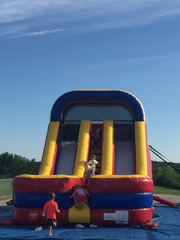 The event provided school supplies and safety information, such as Green Dot to parents & children.  Kids also enjoyed playing on an inflatable obstacle course, drop slide and basketball hoop.